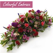 Colourful Embrace Casket Spray